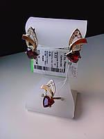 Комплект серебряных украшений с красным камнем - фианитом и золотом