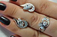 Набор украшений из серебра с золотом. Серебряное кольцо и серьги с фианитами