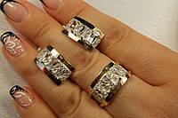 Красивый набор серебряных украшений с золотыми вставками