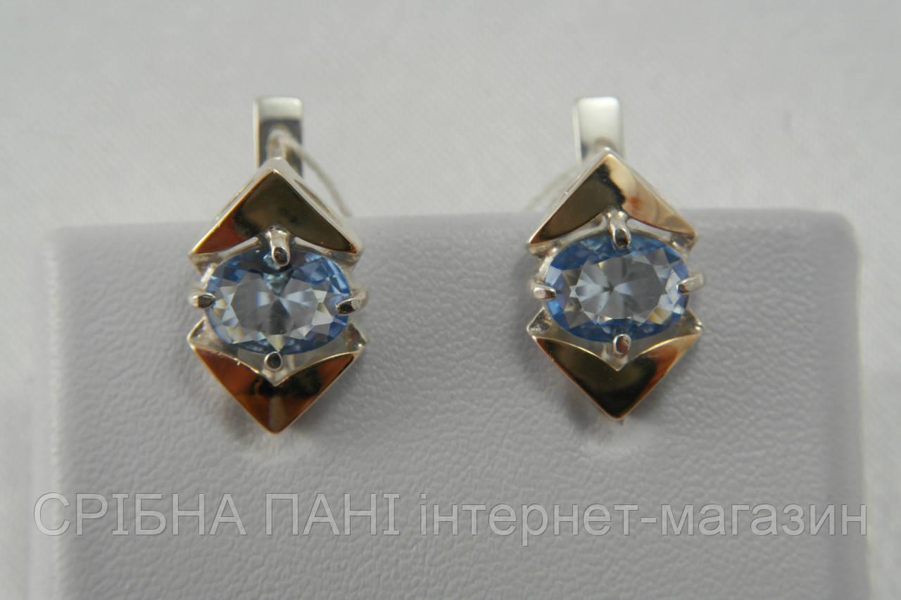 Серьги из серебра с голубыми фианитами и золотом  продажа, цена в ... 54efa036c1b