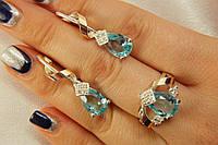 Красивый серебряный комплект с голубым камнем - кольцо и серьги