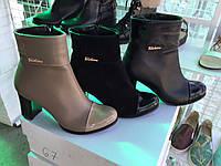 Ботинки на не высоком каблучкен кожаные.