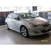 Opel Astra J 2010+ гг. Боковые юбки HB (под покраску)