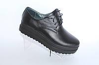 Женские кожаные туфли на платформе черного цвета