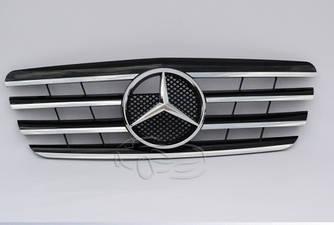 Решетка радиатора Mercedes W210 (99-02) стиль AMG (черная / хром полоски)