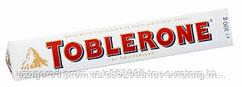 Шоколад белый Toblerone with honey & almond noucat 0.100 гр