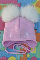 Зимняя шапочка утепленная  с меховыми помпонами.