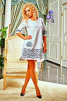 Модное платье с ажурным узором на карманах