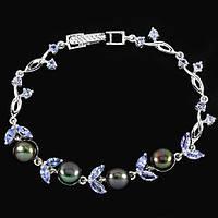 Серебряный браслет с таитянским жемчугом и танзанитами