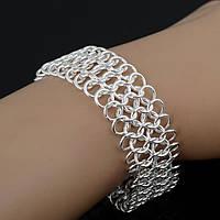 Плетеный серебряный браслет