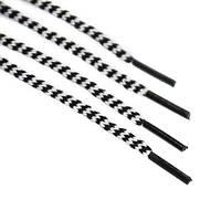 Шнурок 3 мм круглый бело черный с наполнителем 80 см