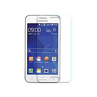 Защитное Стекло на Самсунг Galaxy Core 2 Duos G355H Тонкое 0.26 мм гладкие стороны и углы 2.5D