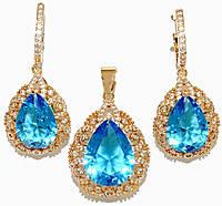 """Набор ХР """"кулон и серьги """"Цвет: позолота; Камни:голубой циркон и россыпь белых фианитов.Диаметр: 1,5см"""