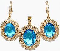 """Набор ХР """"кулон и серьги """"Цвет:позолота; Камни:голубой циркон и россыпь белых фианитов.Диаметр: с-1,8см  к-2см"""