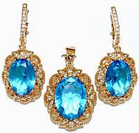 """Набор ХР """"кулон и серьги """"Цвет:позолота; Камни:голубой циркон и россыпь белых фианитов.Диаметр: с-1,5см  к-2см"""