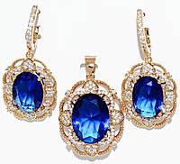 """Набор ХР """"кулон и серьги """"Цвет:позолота; Камни:синий циркон и россыпь белых фианитов.Диаметр: с-1,8см  к-2см"""