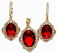 """Набор ХР """"кулон и серьги """"Цвет:позолота; Камни:красный циркон и  белые фианиты.Диаметр: с-1,5 см  к-2 см"""