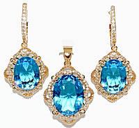 """Набор ХР """"кулон и серьги """"Цвет:позолота; Камни:голубой циркон и  белые фианиты.Диаметр: с-1,5 см  к-2 см"""