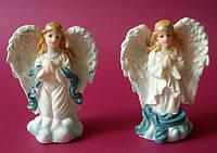 Фигурка ангела средняя с голубыми крыльями на коленях  0526(код 02287)
