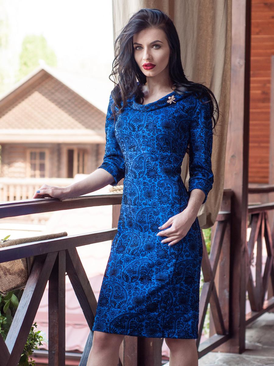 Нарядное женское платье с украшением