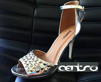 Босоножки на высоком каблуке серебристые с шипами размер 38,5