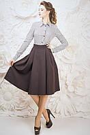 Модная женская юбка за коленка