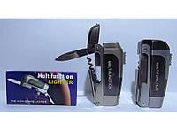 Мультифункциональная зажигалка с ножом и штопором.