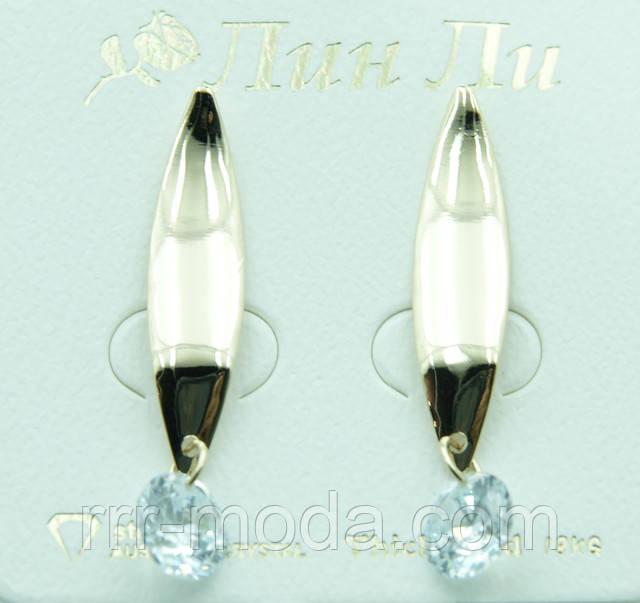 Небольшие женские серьги с крупным кристаллом.