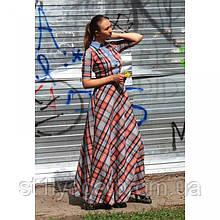 Расклешенное длинное платье в крупную клетку