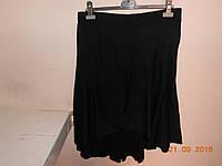 Зимняя трикотажная юбка с удлиненной спинкой