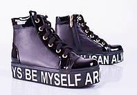 Женские кожаные ботинки на плоской танкетке