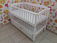 """Дитяче ліжечко Дубок """"Еліт """" сніжно біле з відк.боковинкою та шухлядою."""