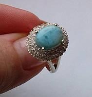 Серебряное кольцо с ларимаром (10х7мм) и топазами