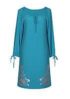 Женское платье свободного кроя с длинным рукавом и глубоким регулируемым вырезом.