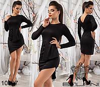 Короткое платье асимметричной длины с глубоким вырезом на спине