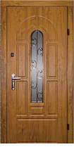 Двері зі склом і ковкою