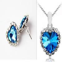 Набор сережки + подвеска с голубым камнем