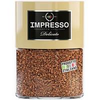 Растворимый кофе с добавлением молотого зерна  IMPRESSO Delicato в стеклянной банке 100 грамм