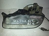 Фара электрическая левая Mazda 323 BA F 1994-1998 года. БУ. Код в каталоге BC6A510L0C