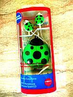 Наушники вакуумные, вкладыш божья коровка, шнур - рулетка, зеленые