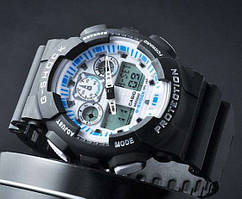 Спортивные часы Casio G-Shock GA 100 с белым дисплеем