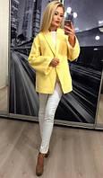 Женское пальто свободного кроя на потайной кнопке