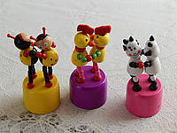Детские деревянные танцующие  игрушки