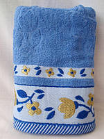Яркое махровое полотенце. Размер: 1,0 x 0,5