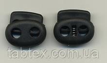 Фиксатор 2х дырочный бол.черный  (1000 шт) пласт.под 6мм шнур
