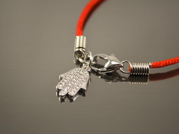 Красный браслет от сглаза Хамса