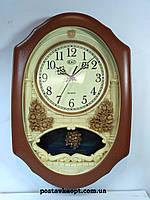 Часы настенные с маятником  и с боем 812