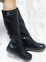 Зимние натуральные кожаные сапоги с мехом по всей длине черного цвета
