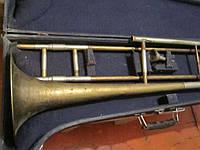 Тромбон в кофре с мундштуком