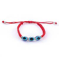 Браслет плетённый из красного шнура с тремя синими глазками